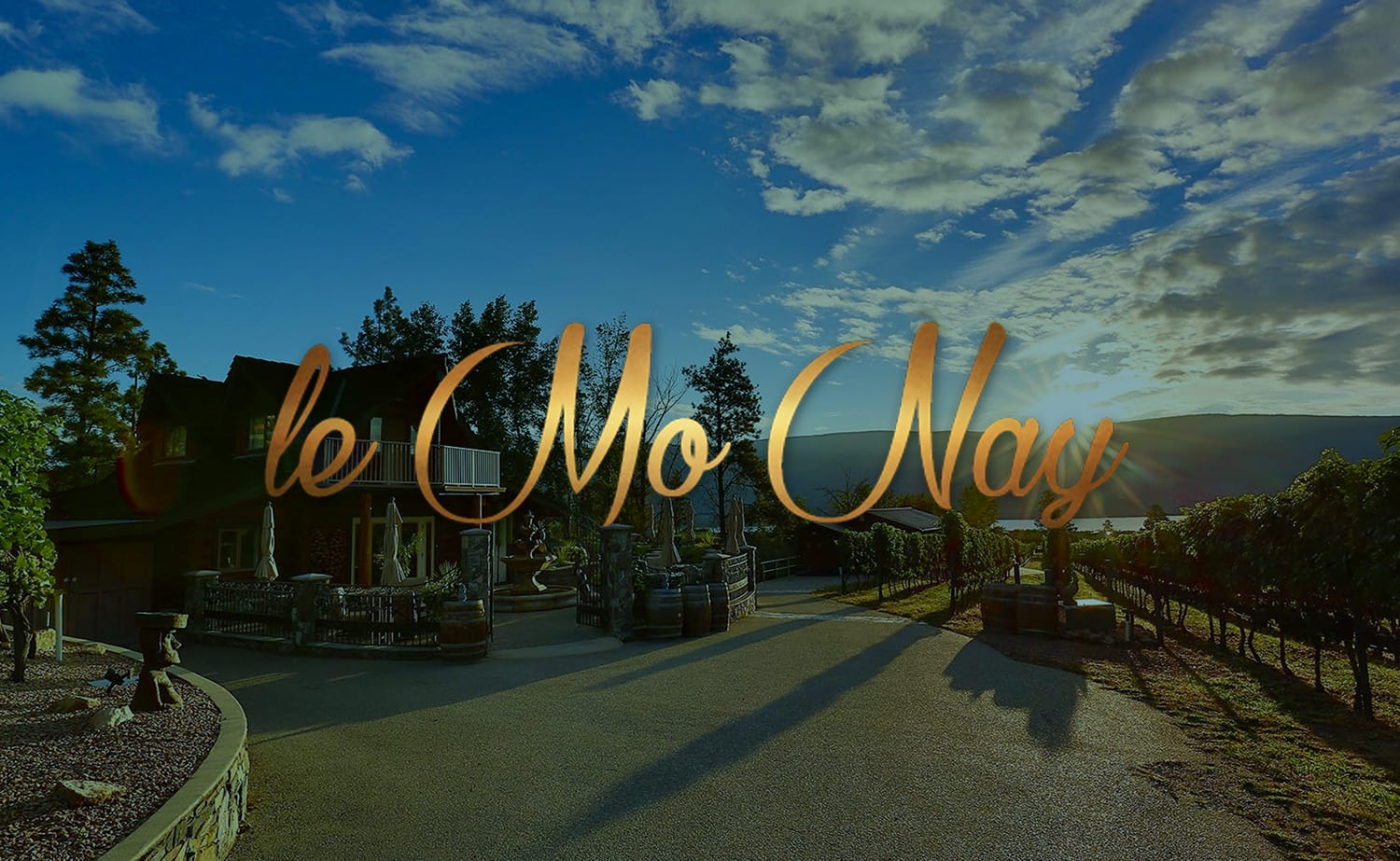 "title ""le mo nay"" with an orchard and winery displayed in the background"