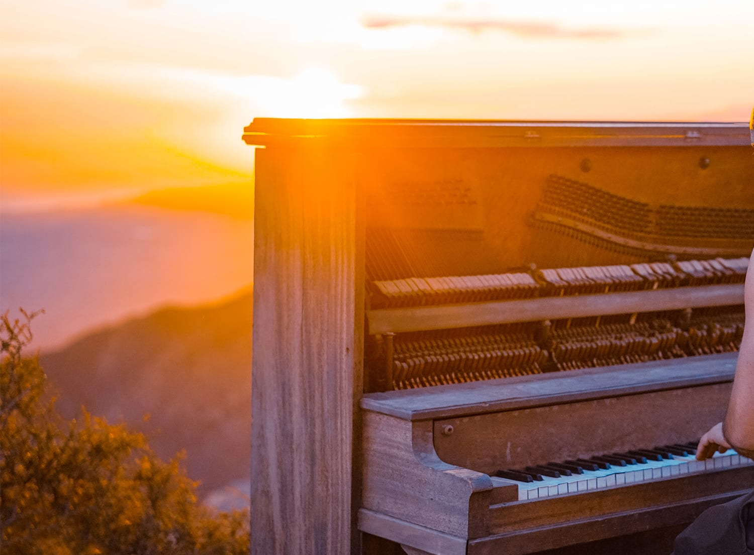 closeup of a piano overlooking a valley